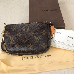 Louis Vuitton mini pochette wristlet authentic